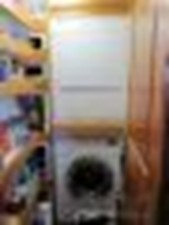 Pantry w/ Full Size Miele Washer & Dryer
