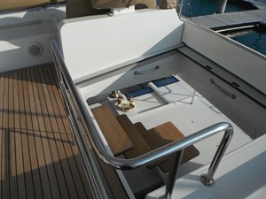 Lagoon 620 -  Steps down to aft from Flybridge (Port)