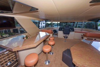 GOLDEN TOUCH 35 ENCLOSED FLYBRIDGE - Looking aft - Bar & seating at left