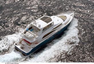 JOHNSON 80' FLYBRIDGE w/FISHING COCKPIT 10 At sea
