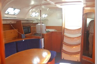 Salon looking aft, stairs, galley, midcabin stateroom