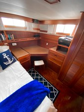 Owner's stateroom teak desk, night stand,book shelves