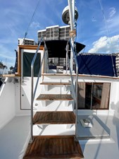 Flybridge steps with teak treads, SS safety rail