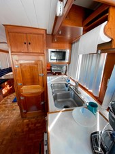 Galley looking aft to refrigerator and freezer, double s/s sink, microwave