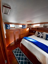 Owner's stateroom island queen, starboard locker and bureau