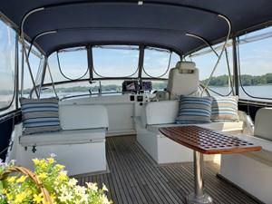 Flybridge seating, helm seat, full bimini with enclosure