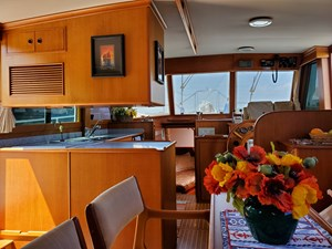 Looking forward to L galley from starboard settee