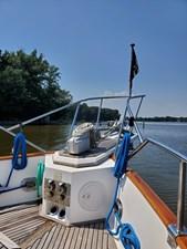 Foredeck with anchor windlass and anchor platform, teak deck