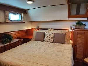 Aft cabin island queen bed, bureau, hanging locker