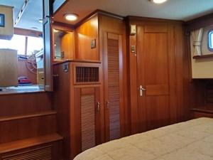 Aft cabin looking forward, hanging lockers, door to shower