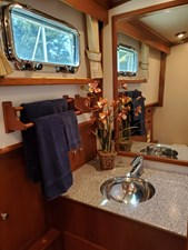 Aft head with stainless steel sink, marble countertop