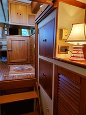 Companionway looking aft, cupboards and hanging locker