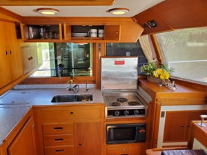 3 burner range with cover, storage drawers, refrigerator