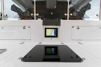 Garmin display in cockpit, rod storage cabinets