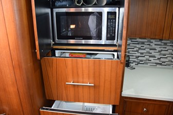 Microwave above refrigeration