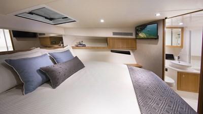 Riviera-39-Open-Flybridge-Master-Stateroom-02-Satin-Oak-Timber-Finish
