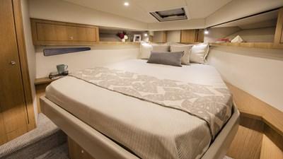 Riviera-39-Open-Flybridge-Master-Stateroom-01-Satin-Oak-Timber-Finish