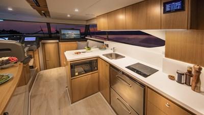 Riviera-39-Open-Flybridge-Galley-01-Satin-Oak-Timber-Finish