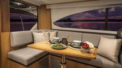 Riviera-39-Open-Flybridge-Dinette-01-Satin-Oak-Timber-Finish