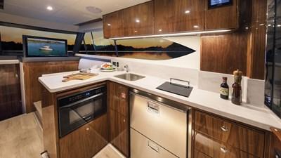 Riviera-39-Open-Flybridge-Galley-02-Gloss-Walnut-Timber-Finish