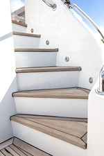 2003 100' Hatteras Motor Yacht stairs to flybridge