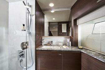 y85-interior-starboard-cabin-bathroom-walnut-satin