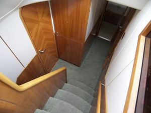 Stairs Down, Left Turn to Full Beam Master Stateroom