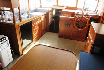 Salon, forward to Galley, Fore Cabin entrance & Helm Station