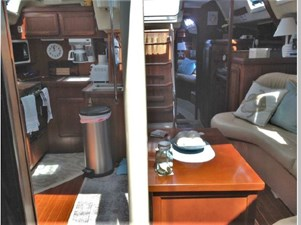 LOOKING AFT FROM GUEST CABIN GALLEY LEFT. LADDER CENTER, ACCESS TO MASTER CABIN RIGHT