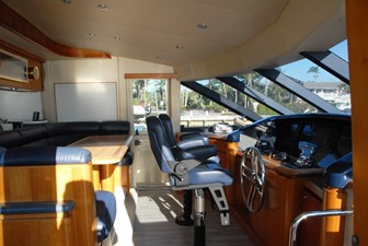Pilothouse opens to galley with seating for 7