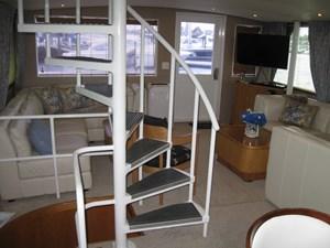 Ocean Romance_Main Salon Circular Stair to Fly Bridge