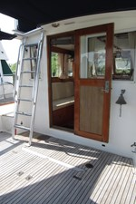 Door from cockpit and ladder to flybridge