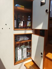 Liquor/food storage to starboard of companionway