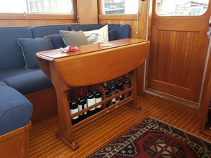 Sliding door from cockpit, yacht table with bottle storage