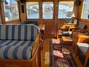 Salon on helm deck with double helm seat, aft entry door