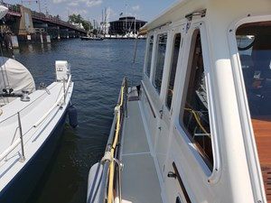 Starboard side deck with non-skid, stainless steel safety and grab rails