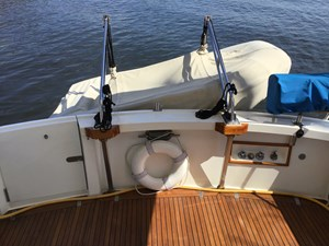 Teak cockpit sole, transom door, cockpit shower, stainless steel davits, dinghy with cover