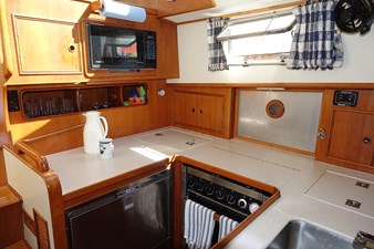 Galley-micriwave, ss refrigerator, Force 10 gas range, Corian countertops