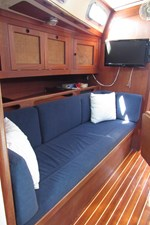 Starboard settee and storage, looking aft