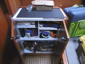 Third cabin cabinet converts to work bench with storage