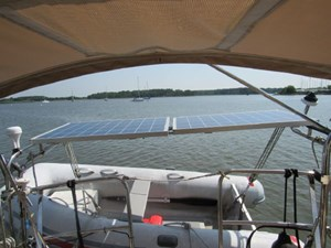 Dinghy on davits and solar panels