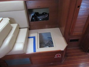 Abundant Storage under and behind settee