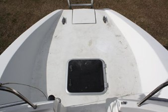 The transom extension as seen from the cockpit. The centerline hatch offers enough space for a couple scuba tanks and other gear. There is an integrated boarding ladder as well as two retractable cleats at the stern.
