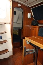 To port and just aft of the companionway is the second stateroom. The bunk in this cabin is enormous, with loads of easy access storage.