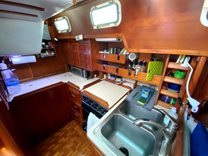 galley with SS sink, oven/stove, toaster, refrigerator & microwave