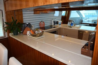 Galley serving counter to Dining