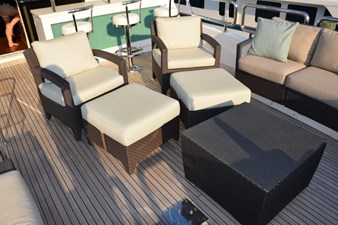 Flybridge armchairs, ottomans, cocktail table