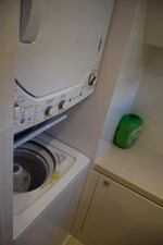 Private laundry room in Master