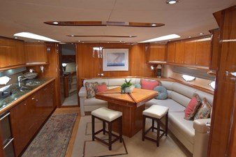 Main Salon with Settee to Stbd. and Galley to Port