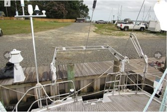 Pole for antennae, davits, outboard motor hoist and mount